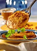 Soft cheese pancakes with sea buckthorn syrup & lemon balm