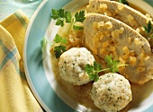 Braised pickled turkey with bread dumplings, onions, parsley
