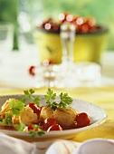 Turkey medallions with cherry sauce and potato crowns