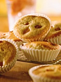 Apricot muffins in paper cases on cake rack