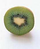 Halved kiwi fruit, lying on its side
