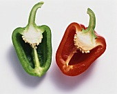 Half a red and green pepper on white background