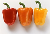 Whole, red, orange and yellow peppers