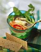 Asparagus & tomato salad with mangetout in glass; crispbread