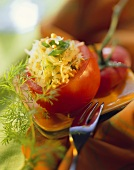 Stuffed tomato with buckwheat, sauerkraut, spring onions