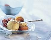 Damson dumplings with chopped hazelnuts on plate