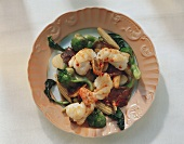 Scampi with spicy vegetables (corncobs, spinach, broccoli)