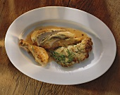 Free-range cockerel with herb dumpling stuffing & rosemary
