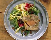Pheasant terrine with mushrooms & pistachios on salad leaves