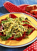 Courgette salad with cheese & cress on radicchio leaves