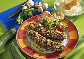 Courgettes with cheese & mushroom stuffing on plate; bread