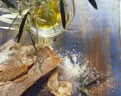 Still life with olive baguette, olive oil & coarse salt