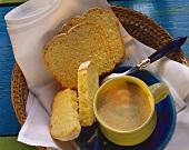 White sandwich loaf in bread basket with coffee cup
