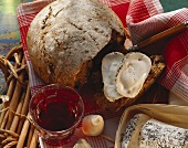 French country bread, slices cut, with cheese & red wine