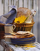 Finnish barley flat bread on pile of plates & in basket