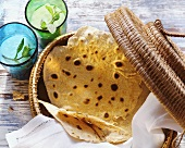 Indian chapatis in a basket; mint drink