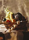 Still: vegetables in basket & garlic on wooden table
