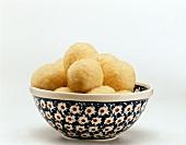 Potato dumplings in a coloured dish