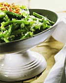 Green bean salad with diced bacon and onions