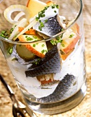 Herring salad with apples, onions and yoghurt dressing in glass