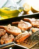 Baked seasoned salmon fillets on baking tray