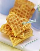 Heart-shaped potato waffles; small plastic forks