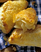 Apple turnovers from quark puff pastry, one cut into