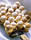 Profiterole star with mandarins, cream & icing sugar