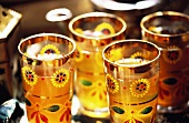 Mint tea in colourful glasses with gold rim