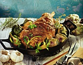 Leg of lamb with artichokes and spring onions in pan
