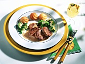 Pork fillet with broccoli, duchess potatoes, white wine