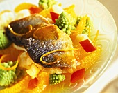 Salad of sea bass with orange sauce and romanesco