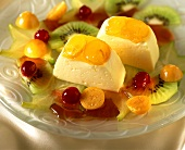 Orange mousse with marinated fruit on plate