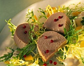 Tuna mousse, three slices on frisee; cranberries
