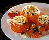 Stuffed grilled tomatoes with rice and cheese on plate