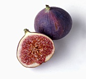 A fig and half a fig on white background