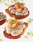 Zwieback (rusk) with salmon mousse, salmon strips and dill
