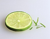 A slice of lime on light background