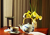 Asian tea arrangement with perfume lamp and flowers