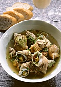 Whelks in pepper stock with aioli; baguette