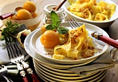 Pappardelle with cinnamon sugar and fresh apricots on plate