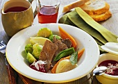 Beef with vegetables and beetroot sauce on plate