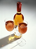 Two Glasses of Rose Wine with Bottle