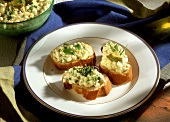 Canapes with egg spread and gherkins on plate