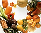 Fruit still life with vegetables & edible flowers round border
