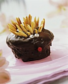 Hedgehog muffins with chocolate icing and almond slivers