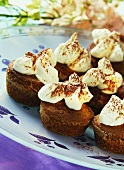 Pharisee (rum coffee) muffins with whipped cream & cocoa powder
