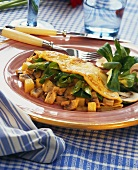 Potato and mushroom pancakes with corn salad on red plate