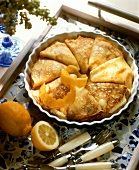 Souffled quark pancakes with lemon peel in quiche dish