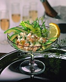Shrimp cocktail with avocados and dill in glass bowl